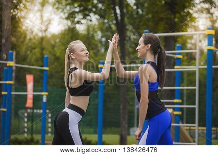 Two girls celebrate the victory after important competitions