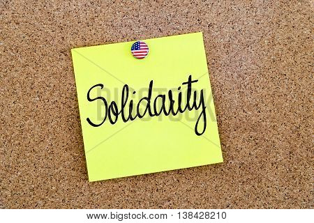 Written Text Solidarity Over Yellow Paper Note