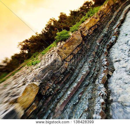 Horizontal viviid geological rock cut bokeh background backdrop