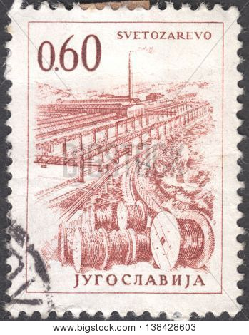 MOSCOW RUSSIA - JANUARY 2016: a post stamp printed in YUGOSLAVIA shows a plant in Svetozarevo the series