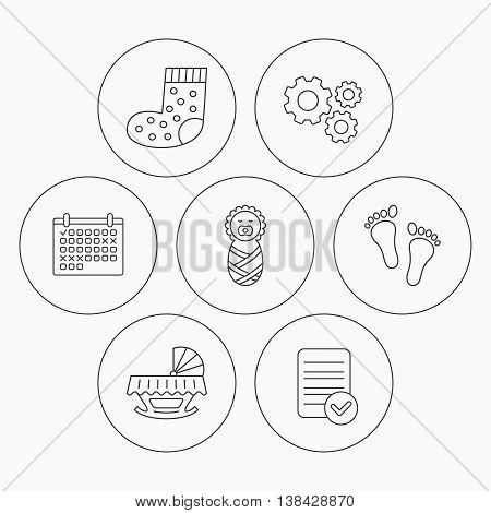 Footprint, cradle and newborn baby icons. Socks linear sign. Check file, calendar and cogwheel icons. Vector