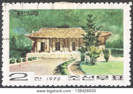 MOSCOW RUSSIA - CIRCA JANUARY 2016: a post stamp printed in the NORTH KOREA shows a traditional Korean building the series