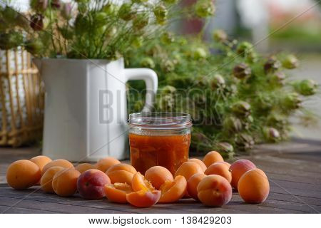 many apricots and a  pot of jam