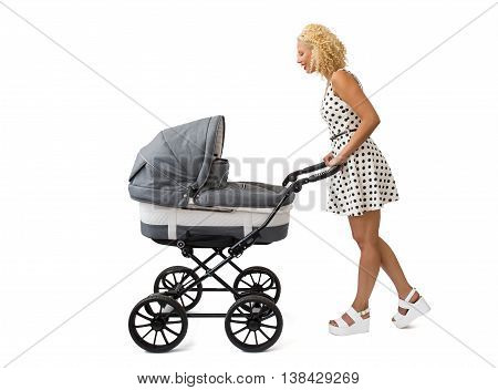 Woman with baby carriage looking at baby