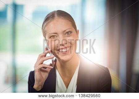 Portrait of businesswoman talking on mobile phone in the office