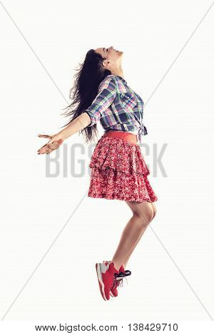 modern style hip-hop dancer posing, dreaming or flying