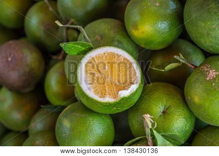 fresh green oranges on table box in Cambodia