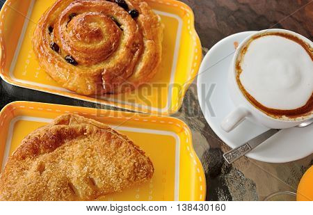 bakery and cappuccino close up breakfast background .