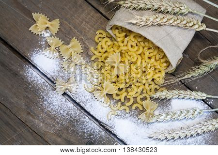 Uncooked Italian Pasta Farfalle And Elbow Macaroni In Canvas Little Bag
