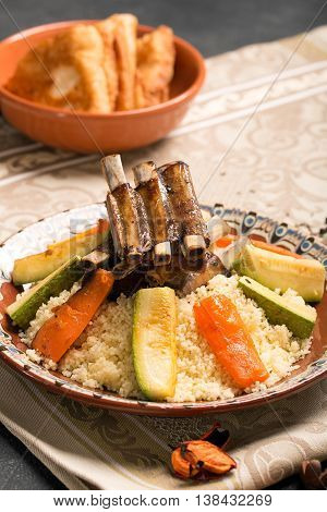 Traditional couscous dish with lamb ribs and vegetables. Still life. The image is describing moroccan cuisine