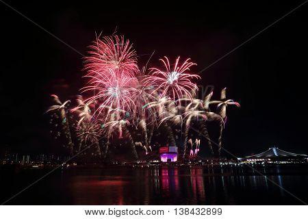 Fireworks celebrating Singapore's National Day across Kallang River