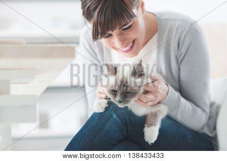 Smiling Woman Cuddling Her Cat