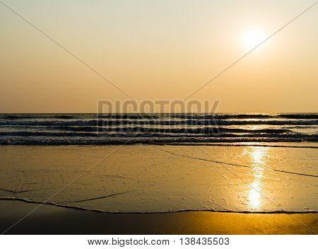 Horizontal vivid golden tidal waves with sun reflection background backdrop