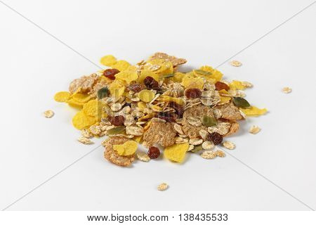pile of corn flakes and cereals on white background
