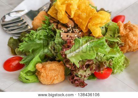 Healthy salad made of cucumber tomato tofu sesame seeds and fresh onion