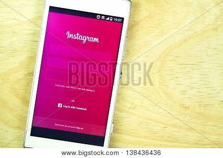 BUNG KAN THAILAND - JANUARY 15 2016: smart phone display instagram app on office desk log in