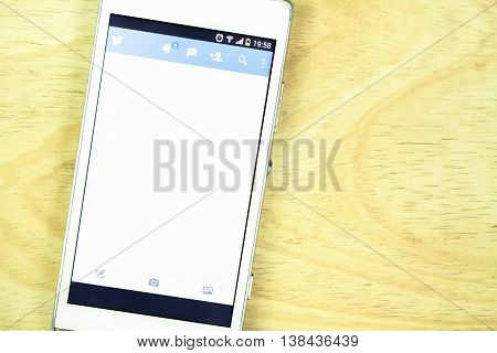 BUNG KAN THAILAND - JANUARY 15 2016: smart phone display twitter app on office desk