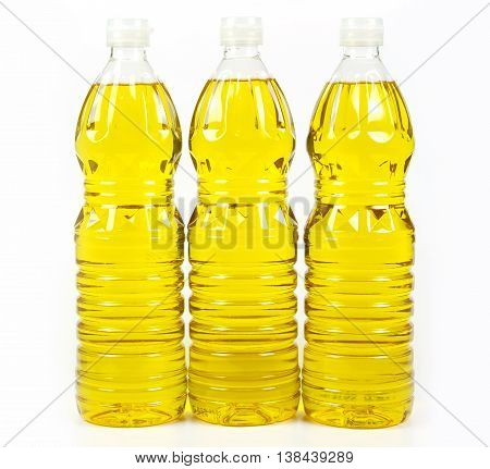 three bottles oil of refined palm oil from pericarp