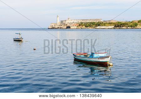 HAVANA, CUBA - MARCH 17, 2016: Reflection of a boat near the Morro Castle on the shore in Havana the capital of Cuba
