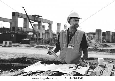 Construction Worker Planning Contractor Checking Concept