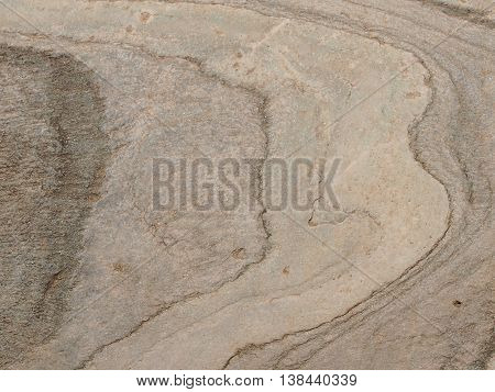 Beautiful drawing on a stone column - wavy texture