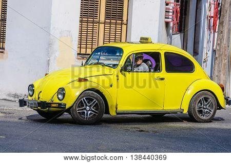 HAVANA, CUBA - MARCH 17, 2016: Old yellow Wolksvagen in Havana the capital of Cuba