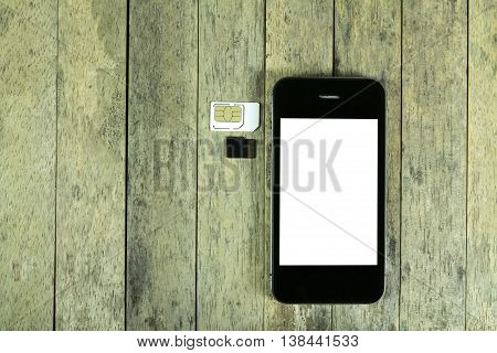 smart phone and sim card micro sd card on wood background