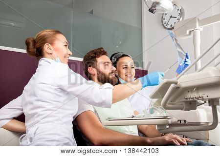 Dentist Shows A Patient X-ray Of Teeth