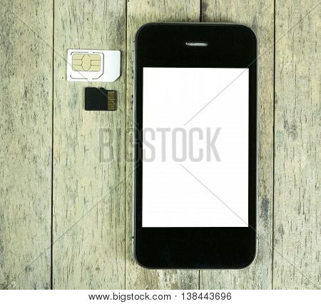 smart phone on wood table with sim card and micro sd card