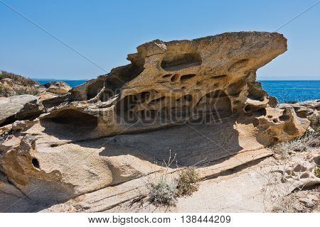 Picturesque rock at coast of a small uninhabited island near coast of Sithonia, Greece