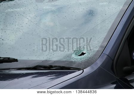 A Smashed Car Windscreen on a Wet and Rainy Day.