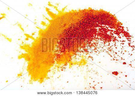 Turmeric (Curcuma) and paprika powder on white