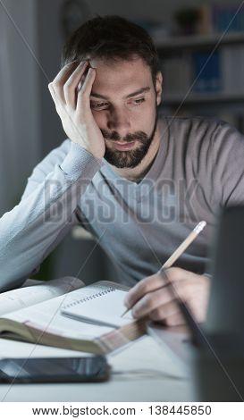 Sleepy Young Man At Desk