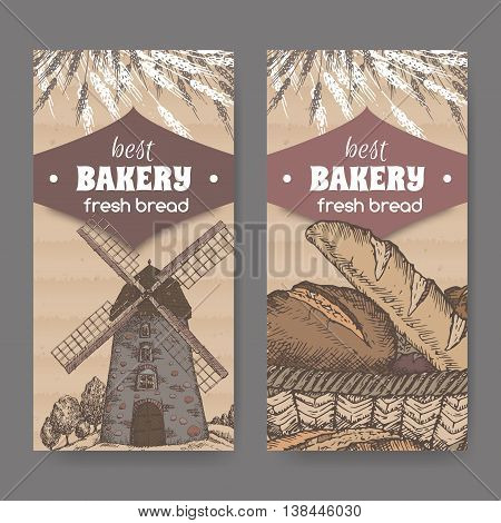 Set of two color vintage bakery label templates with old stone windmill, wheat and bread on cardboard background. Great for bakery and bread shop ads, brochures, labels.