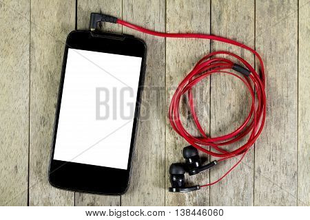 smart phone and earphones on wood table top view