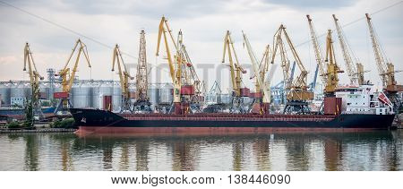Industrial port with cranes and ship. Odessa