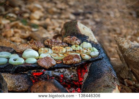 meatballs baked in the embers of tile stone