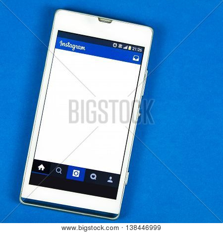 BUNG KAN THAILAND - FEBRUARY 19 2016: smart phone display Instagram app on blue background space for caption