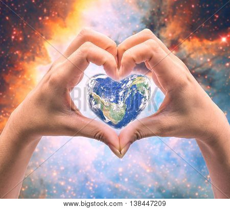 World In Heart Shape With Over Women Human Hands On Blurred Natural Background: World Heart Health D