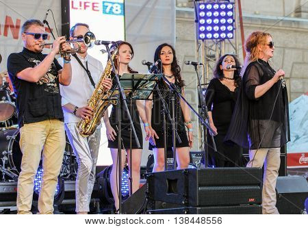 St. Petersburg, Russia - 2 July, Musicians with the girls beg vocals, 2 July, 2016. Annual international festival of jazz and blues in St. Petersburg.