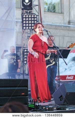 St. Petersburg, Russia - 2 July, Singing soloist on the stage at the microphone, 2 July, 2016. Annual international festival of jazz and blues in St. Petersburg.