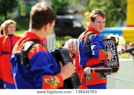 Orel Russia - July 08 2016: Russian Valentine Day - Petr and Fevronia. Men in Russian outfits playing Russian accordion selective focus