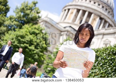 Tourist reading a map by st pauls cathedral