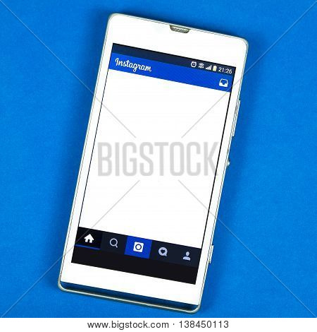 BUNG KAN THAILAND - FEBRUARY 19 2016: smart phone display Instagram app on blue background