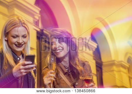 Two beautiful girls drinking and having fun on a girls' night out