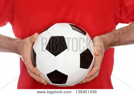 holding a leather ball in two hands