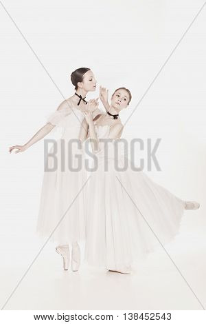 Romantic Beauty. The portrait of a two woman as ballerinas in retro style on white background