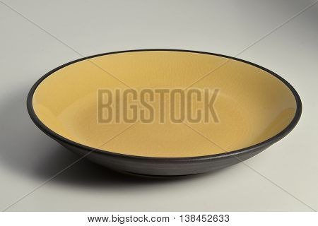 Isolated Black plate with internal glazed amber