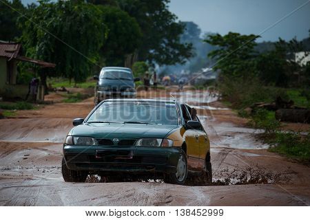 Yongoro Sierra Leone - May 31 2013: West Africa the village of Yongoro in front of Freetown road affected by rain