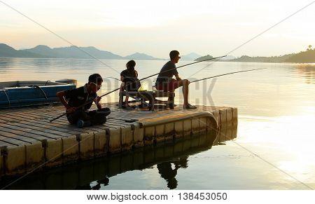 Fishing by the jetty of Batang Ai Longhouse Resort, Sarawak, Malaysia.